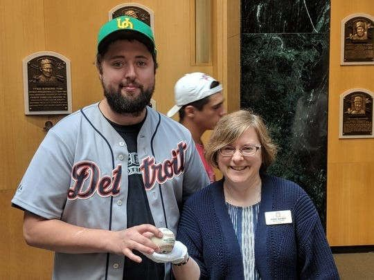 In memory of the late son, Detroit's fan hand-delivers historic Albert Pujol's baseball to Hall of the Fame.